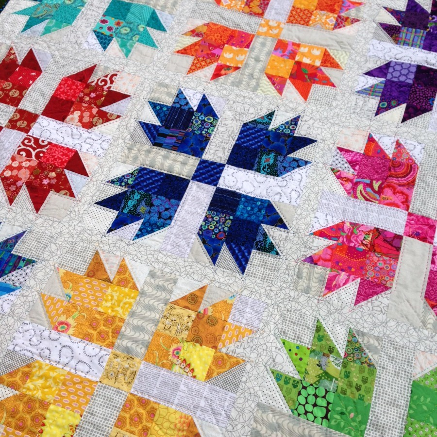 A colorful modern Bear's Paw quilt